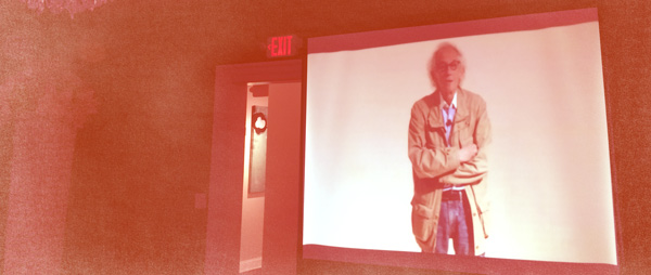 Photograph of the artist Christo presenting at MOCA  simulcast at Sweet Pete's